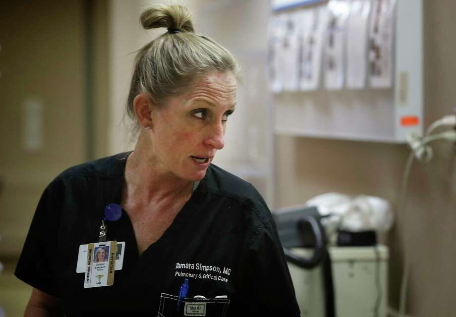 Finished with one procedure on a COVID-19 patient, Dr. Tamara Simpson heads to another patient at Northeast Baptist Hospital on April 24, 2020. Simpson got Nick Wilson into the ECMO program at Methodist. Photo: Bob Owen, San Antonio Express-News / ©2020 San Antonio Express-News