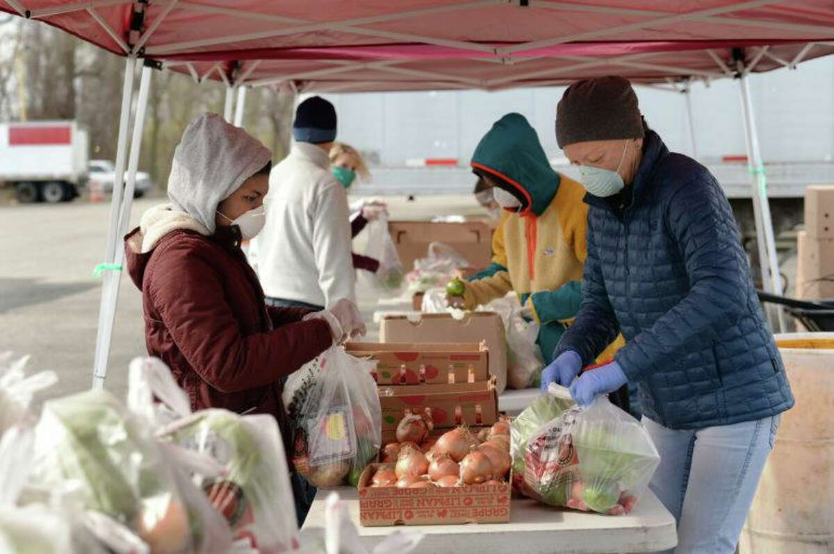 Volunteers package produce for pick up at Foodshare's drive-through food pickup at the Hartford Regional Market.