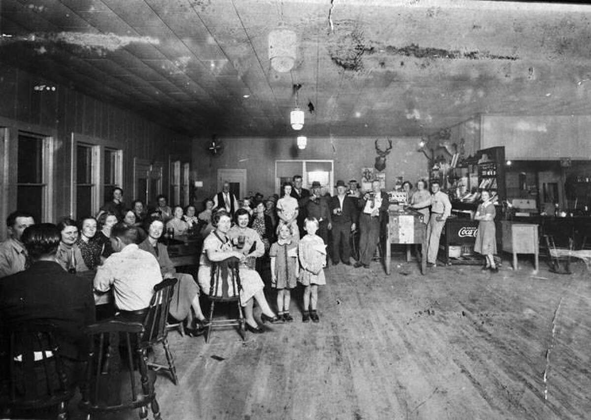 Men, women and children gather in 1937 at Tip's Place, founded by Aviel 'Tip' Vander Poorten in San Antonio near what became Kelly AFB. The cafe had a six-lane bowling alley and was a popular spot for the city's Belgan community.