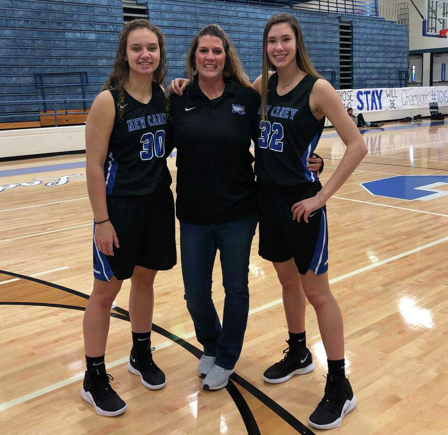 New Caney basketball players Abigail Lynch, left, and Tori Garza, right, pose for a photo with coach Tricia Mize back in December of 2019. Photo: Submitted Photo