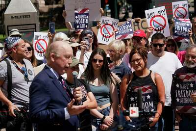 Steven Hotze, a Republican activist, speaks during a rally he organized outside the Harris County offices, 1001 Preston, Thursday, April 23, 2020 in Houston to protest against the order to wear masks. Harris County Judge Lina Hidalgo ordered residents to cover their nose and mouth while in public effective Monday for 30 days amid the Covid-19 pandemic.