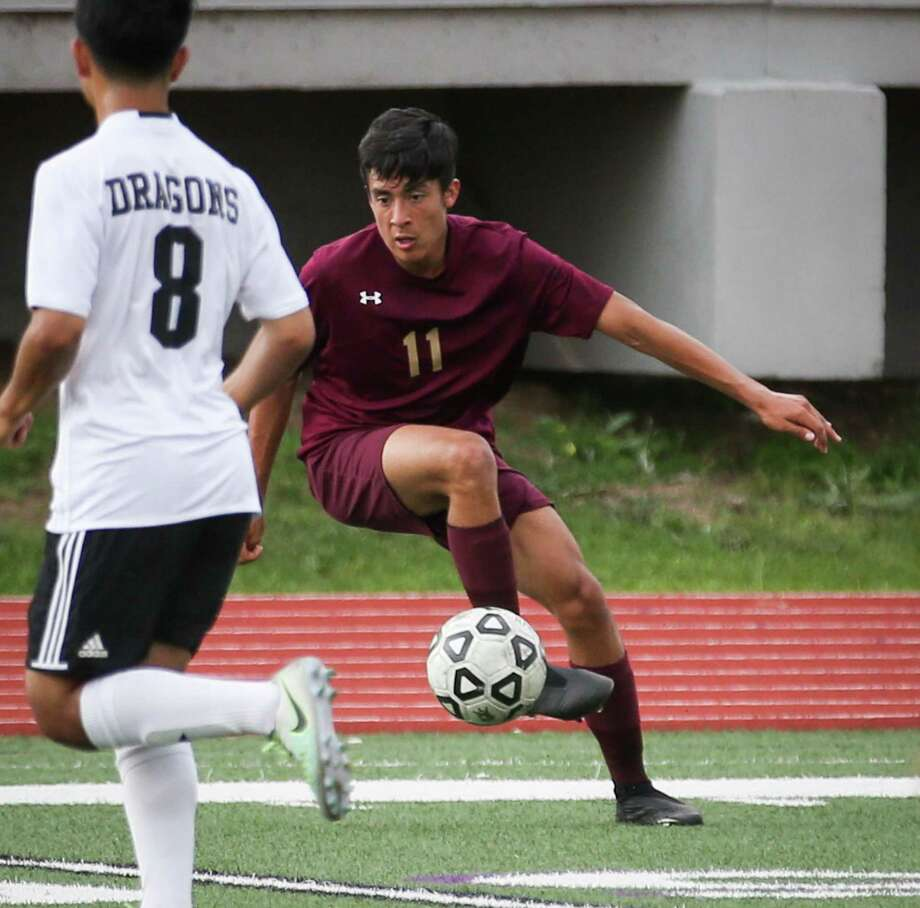 Magnolia West's Carlos Larios (11) controls the ball during the boys soccer game against Nacogdoches on Tuesday, April 3, 2018, at Yates Stadium in Willis. (Michael Minasi / Houston Chronicle) Photo: Michael Minasi, Staff Photographer / Houston Chronicle / © 2018 Houston Chronicle