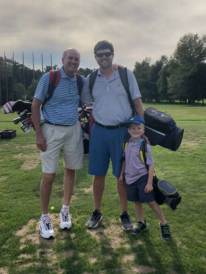 Matt Czarnecki, center, is going to be inducted into the College of Holy Cross Varsity Athletic Club Hall of Fame. Pictured with him are his father John and son, Luke. A Greenwich native Czarnecki starred on the men's golf team at Holy Cross for four years. Photo: Contributed Photo