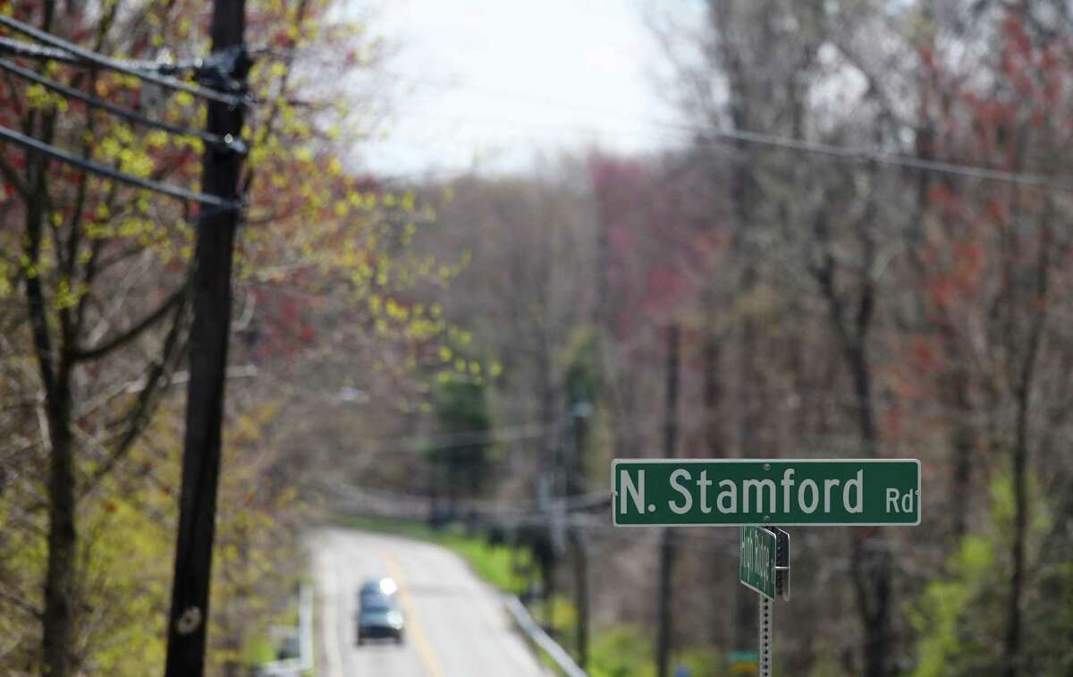 Traffic passes on High Ridge Road near the insersection with North Stamford Road in the vast, wooded neighborhood of North Stamford, Conn. Wednesday, April 22, 2020. North Stamford has been a tough real estate market for years, but folks looking for more space and lower prices are beginning to look to North Stamford as opposed to the dense, fast-growing downtown areas.