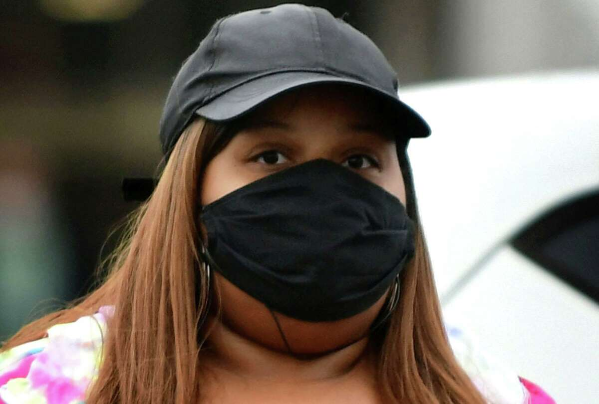 Local residents wear masks against contracting the coronavirus as ordered by the governor Tuesday, April 21, 2020, in Norwalk, Conn.