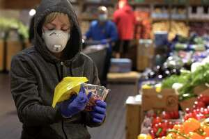 Jane Blackwell, of Brewster, NY, wears a mask while shopping at Stew Leonard's today, less than 24 hours after the implementation of Gov. Ned Lamont's order directing masks to be worn in public setting where social distancing is not possible. Danbury, Conn. Tuesday, April 21, 2020.