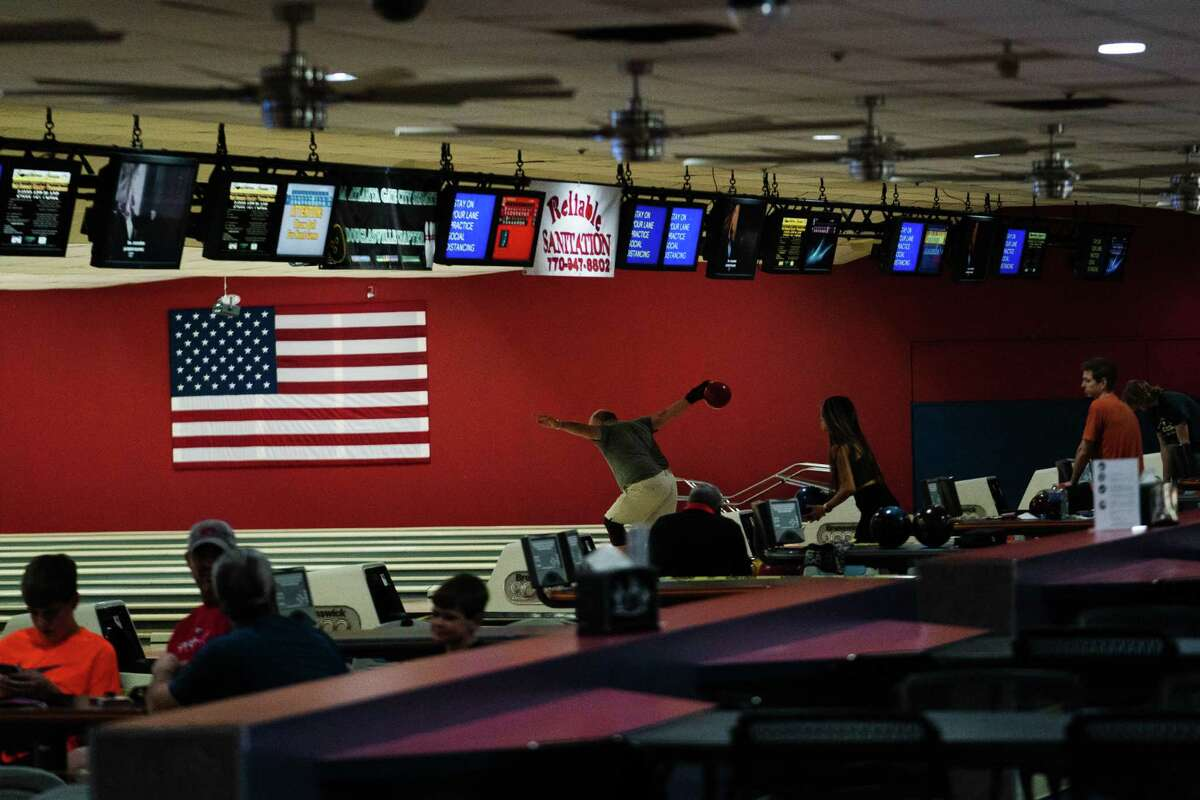 Bowlers return to action at Southern Lanes bowling alley in Douglasville, Ga.