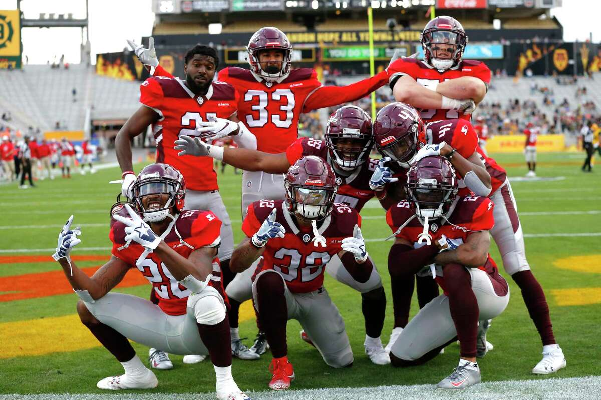 The Commanders celebrate an interception. When XFL teams held joint practices January in Houston, ex-Commanders who were there often ended sessions with group photos.
