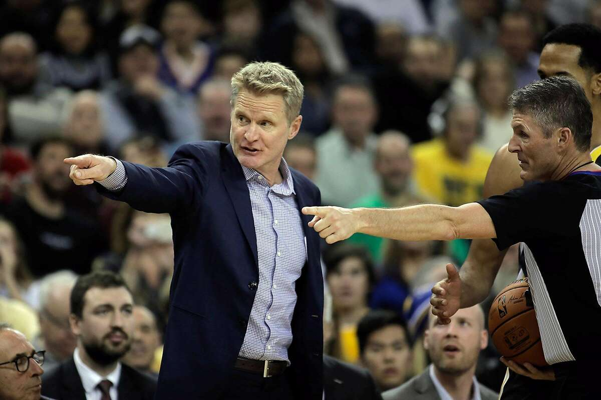 Golden State Warriors head coach Steve Kerr, left, complains about a call during a game against the Los Angeles Clippers on December 23, 2018, at Oracle Arena in Oakland, Calif. (Randy Vazquez/Bay Area News Group/TNS)