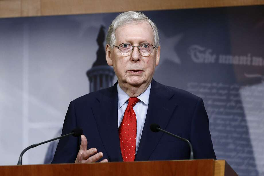 FILE - In this April 21, 2020, file photo Senate Majority Leader Mitch McConnell of Ky., speaks with reporters after the Senate approved a nearly $500 billion coronavirus aid bill on Capitol Hill in Washington. House Speaker Nancy Pelosi shelved a proposal for proxy voting this week after Republicans objected. In the Senate, McConnell rejected a GOP remote vote proposal. He expects Congress to return May 4, as planned. (AP Photo/Patrick Semansky, File) Photo: Patrick Semansky, Associated Press