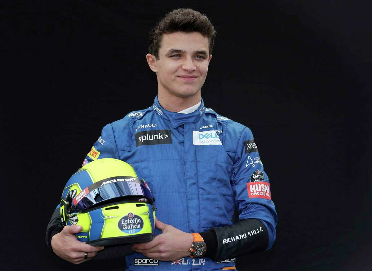 FILE - In this March 12, 2020, file photo, McLaren driver Lando Norris, of Britain, poses for a photo at the Australian Formula One Grand Prix in Melbourne. Formula One driver Norris embarrassed the field in his IndyCar iRacing debut by dominating the race at virtual Circuit of the Americas in Texas, Saturday, April 25, 2020. He was poised to begin his second F1 season with McLaren in March when a team member tested positive for the new coronavirus at the season-opening Australian Grand Prix and the series immediately suspended competition. (AP Photo/Rick Rycroft, File)