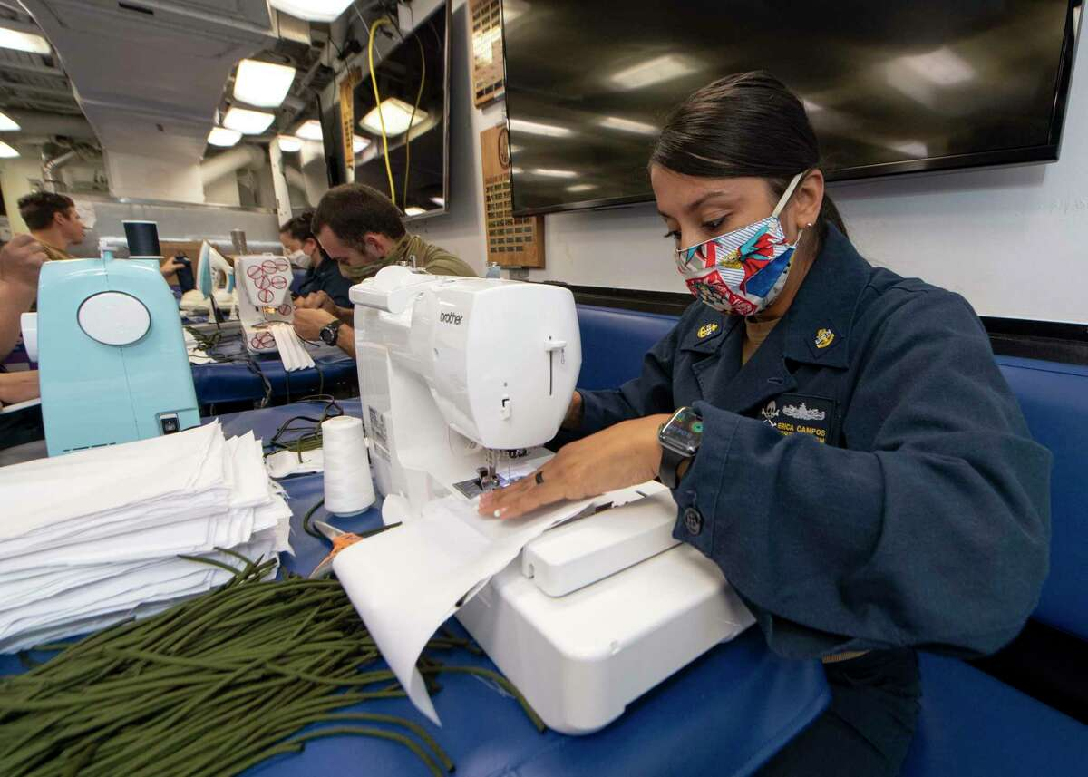 Navy Chief Personnel Specialist Erica Campos, on the USS Kidd, a guided-missile destroyer, makes cloth face masks for the crew on April 6. MUST CREDIT: U.S. Navy handout photo by Brandie Nuzzi