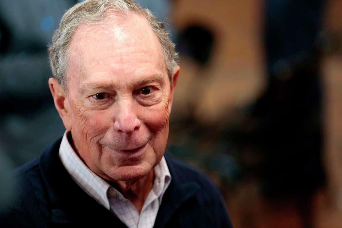(FILES) In this file photo taken on December 21, 2019 2020 Democratic presidential hopeful and former New York Mayor Michael Bloomberg talks to reporters after an event to open a campaign office at Eastern Market in Detroit, Michigan - Michael Bloomberg has qualified for the February 19, 2020 Democratic presidential debate and will square off for the first time with his rivals seeking the party nomination.The former New York mayor has surged to 19 percent support nationally, second to Bernie Sanders at 31 percent, in an NPR/PBS NewsHour/Marist survey.That meant he cleared a polling threshold set by the Democratic National Committee. (Photo by JEFF KOWALSKY / AFP) (Photo by JEFF KOWALSKY/AFP via Getty Images)