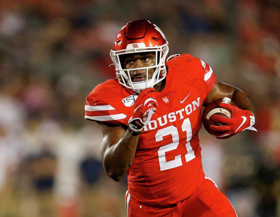 Houston Cougars running back Patrick Carr (21) scores a five-yard touchdown against the Navy Midshipmen during the first quarter of an NCAA game at TDECU Stadium Saturday, Nov. 30, 2019, in Houston. Photo: Godofredo A. Vásquez, Houston Chronicle / Staff Photographer / © 2019 Houston Chronicle