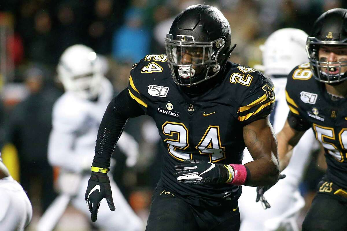 FILE - In this Oct. 31, 2019, file photo, Appalachian State linebacker Akeem Davis-Gaither (24) tracks the offense during the first half of the team's NCAA college football game against Georgia Southern in Boone, N.C. The NFL draft entered its third and final day pmn Saturday, April 25, 2020, with the Cincinnati Bengals selecting the Appalachian State linebacker.(AP Photo/Brian Blanco, File)