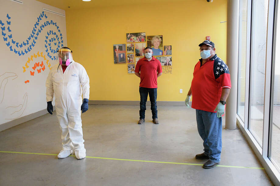 Members of Raquel's Bio Hazard Cleaning, from left, George Gilbert, Giovanni and Juan Martinez provided a free disinfection of the Barbara Kazen Center for Hope at Bethany House, Friday, April 24, 2020. Photo: Cuate Santos/Laredo Morning Times