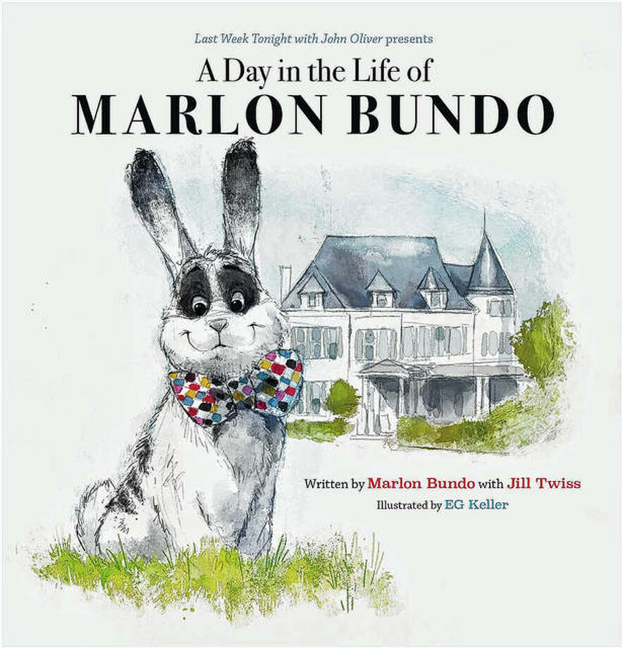 "This cover image released by Chronicle Books shows ""Last Week Tonight with John Oliver Presents A Day in the Life of Marlon Bundo,"" written by Marlon Bundo with Jill Twiss and illustrated by EG Keller. The book was among the top 10 challenged books in 2019, according to the American Library Association. Photo: Chronicle Books Via AP"