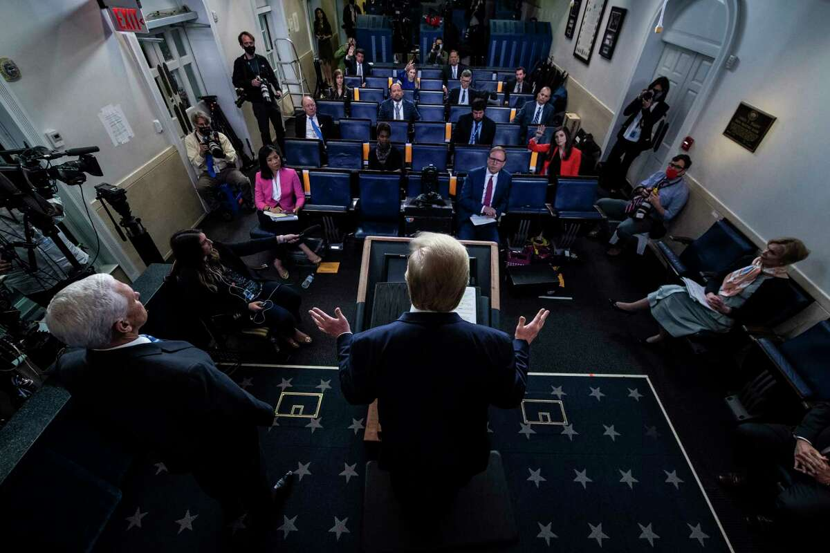 President Donald Trump speaks alongside Vice President Mike Pence, left, at a coronavirus task force briefing. White House officials say privately they are considering scaling back the events.