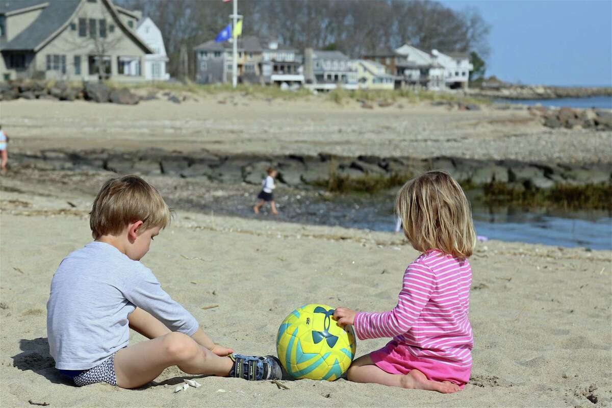 Eoin Corcoran, 5, of Westport, and his sister Jessica, 3, enjoy the sand at Old Mill Beach in Westport, Conn., on Saturday, April 25, 2020.