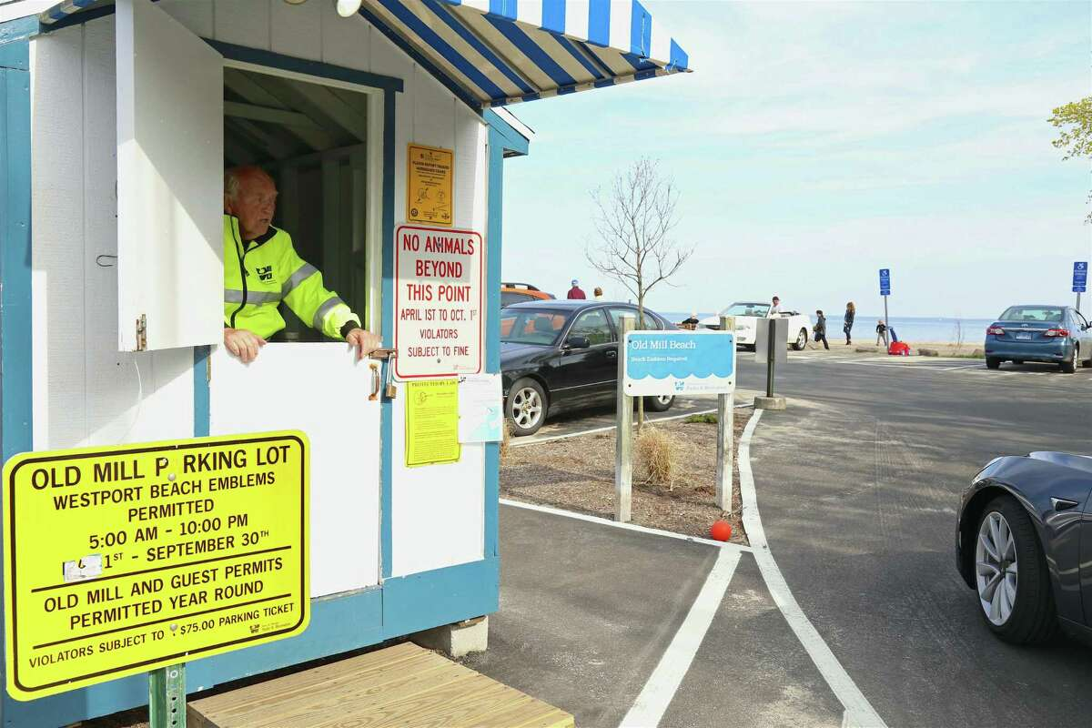 Rich MacDonald explains to a visitor that parking at Old Mill Beach itself is reserved for residents of the beachside community itself, seen here on Saturday, April 25, 2020, in Westport, Conn.