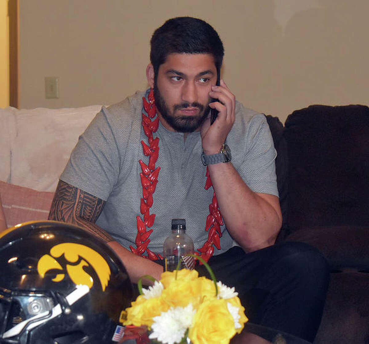 AJ Epenesa on the phone with the Buffalo Bills management team prior to its announced on ESPN that he's being selected with the 54th overall pick in the NFL Draft.