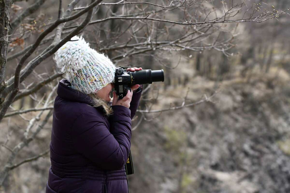 Stacy Smith, with her Nikon camera around her neck, makes her weekly trek on April 17, 2020, to Peebles Island State Park to create lesson plans as a teacher's aide for first-grade students at Harmony Hill School in Cohoes. (Joyce Bassett / Special to the Times Union)
