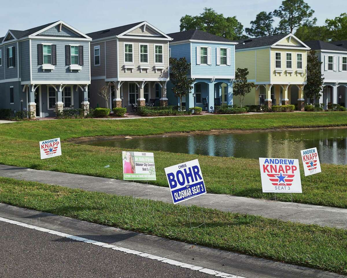 Signs for local candidates are scattered outside during Florida's primary election at the Oldsmar Fire Department voting precinct on March 17 in Oldsmar, Fla.