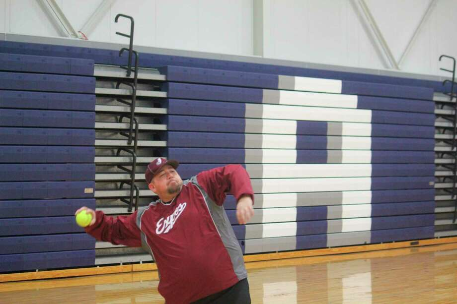 Crossroads softball coach Kevin Brigham works with his team during a preseason practice last season. (Pioneer file photo)