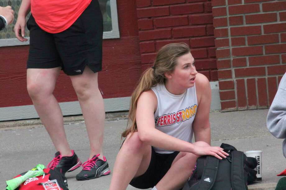 Emily Libey relaxes last year in-between games at the Big Rapids Gus Macker tournament. (Pioneer file photo)