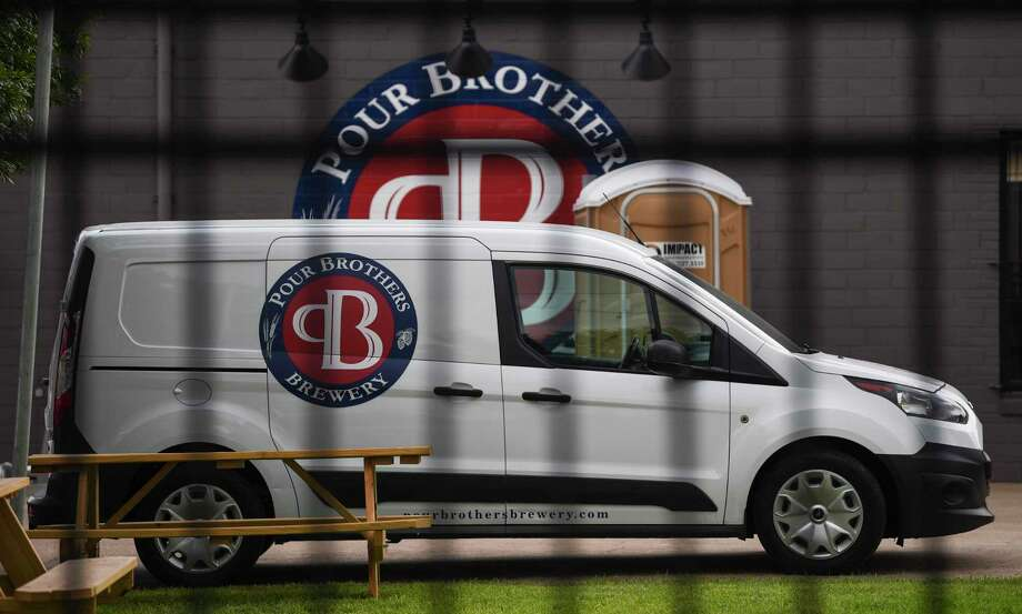 A van with the Pour Brothers Brewery's logo outside the front of the brewery Tuesday. Photo taken on Monday, 09/09/19. Ryan Welch/The Enterprise Photo: Ryan Welch, Beaumont Enterprise / The Enterprise / © 2019 Beaumont Enterprise