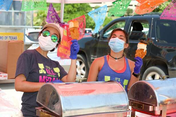 San Antonians celebrate with a drive-thru fiesta hosted by Mi Tierra Cafe and Bakery at the Rim on Saturday, April 25, 2020.