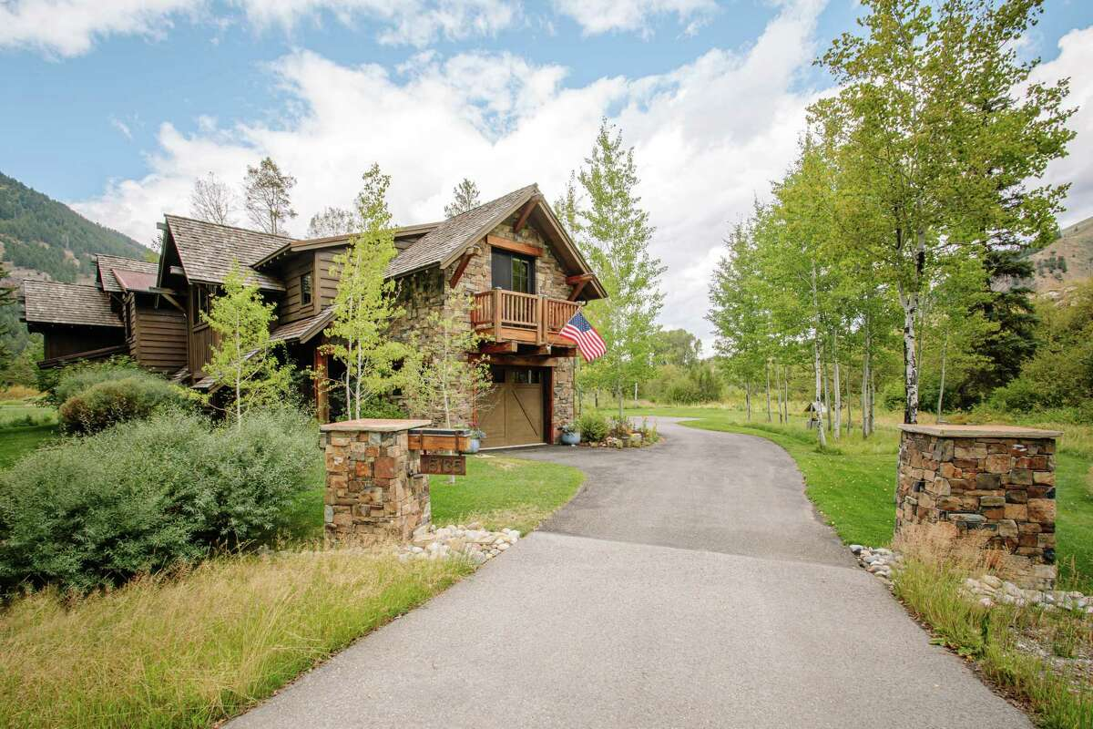 The four-bedroom, four-and-a-half-bathroom at 15135 Martin Creek Road in Jackson, Wyoming features an open floor plan and direct access to the Snake River.