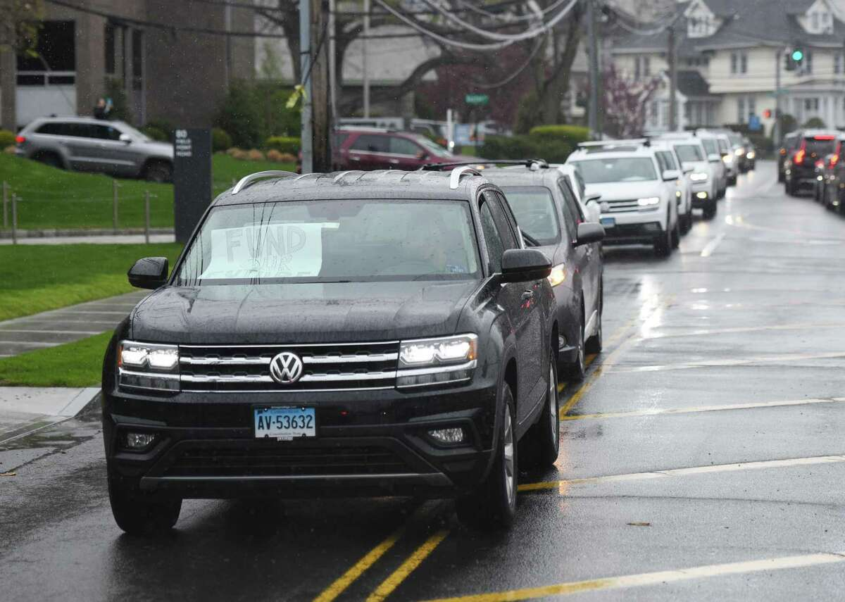 More than 150 cars honk to protest the anticipated cuts to Greenwich public school budget outside of Town Hall in Greenwich, Conn. Sunday, April 26, 2020. One day before the Board of Estimate and Taxation was expected to make potentially steep cuts to the 2020-21 municipal budget, parents had their voices, and horns, heard to demand no cuts to proposed school spending.