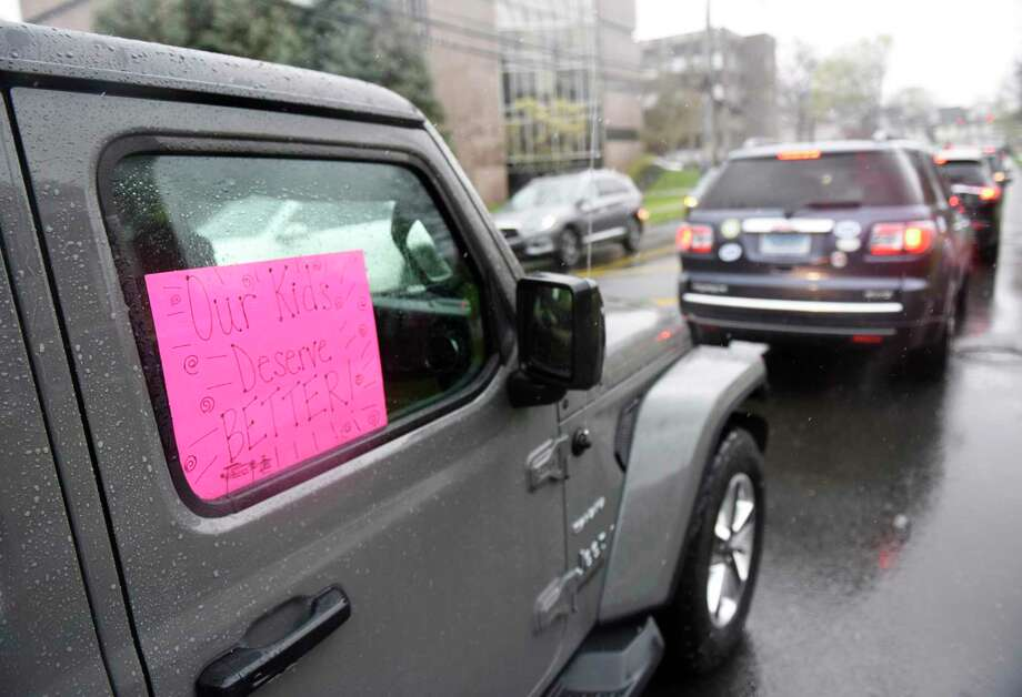 More than 150 cars honk to protest anticipated cuts to Greenwich public school budget outside of Town Hall in Greenwich, Conn. Sunday, April 26, 2020. One day before the Board of Estimate and Taxation was expected to make potentially steep cuts to the 2020-21 municipal budget, parents had their voices, and horns, heard to demand no cuts to proposed school spending. Photo: File / Tyler Sizemore / Hearst Connecticut Media / Greenwich Time