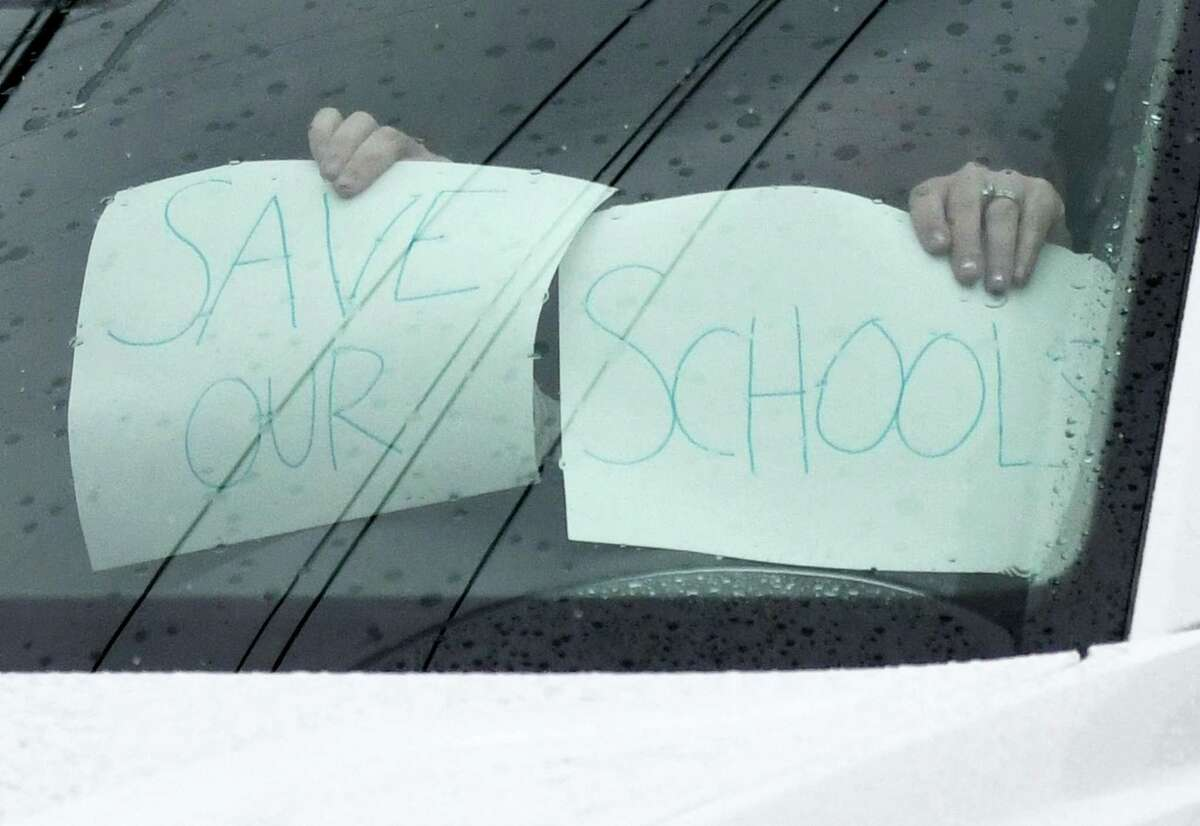 More than 150 cars honk to protest the anticipated cuts to Greenwich public school budget outside of Town Hall in Greenwich last April to protest budget cuts. The issue is already heating up for next year's budget as guidelines are put together.