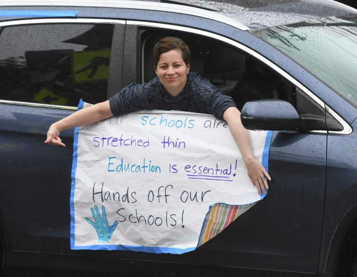 More than 150 cars honk to protest the anticipated cuts to Greenwich public school budget outside of Town Hall in Greenwich, Conn. Sunday, April 26, 2020. The issue is already heating up for next year's budget as guidelines are put together.