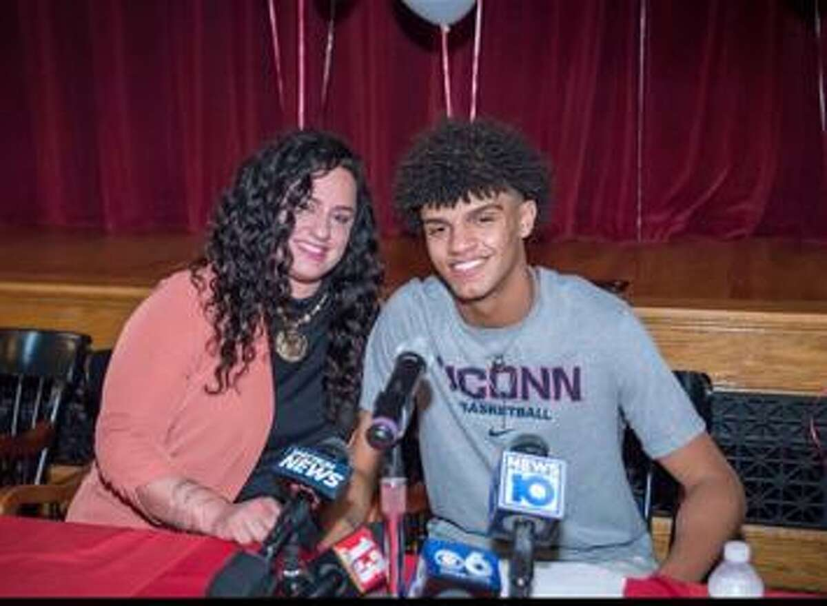Andre Jackson and his mom, Tricia Altieri, on the day Jackson committed to play at UConn.