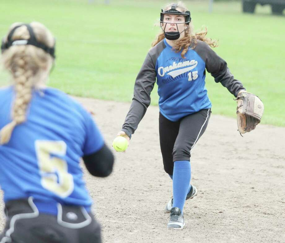 Onekama senior Ella Acton looks to throw out a runner at first base during a game last season. (News Advocate file photo)