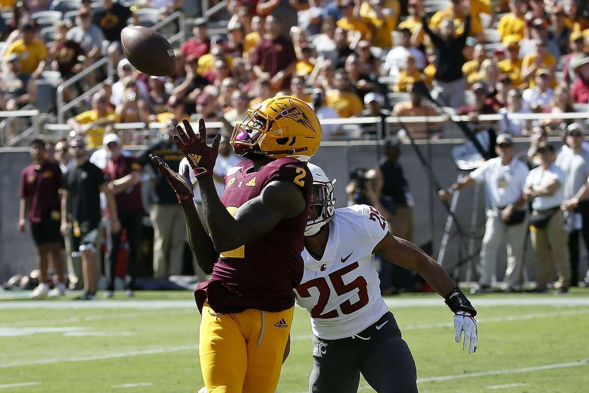 FILE - In this Oct. 12, 2019, file photo, Arizona State wide receiver Brandon Aiyuk (2) reaches out to make a touchdown catch in front of Washington State safety Skyler Thomas (25) during the first half of an NCAA college football game in Tempe, Ariz. This year's NFL draft features a superb group of wide receivers, including Aiyuk, who are expected to make immediate impacts in the NFL. (AP Photo/Ross D. Franklin, File)
