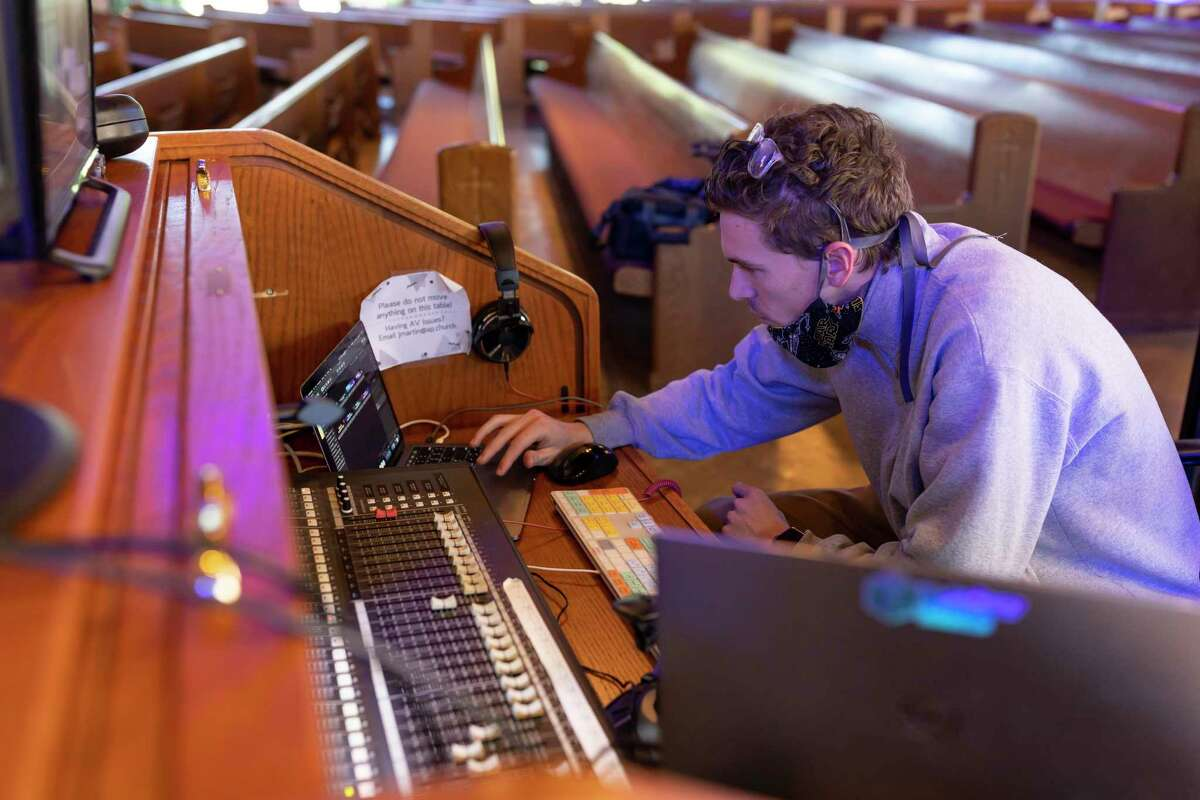 Jay Martin, creative services technician for St Anthony of Padua Catholic Church in The Woodlands, prepares his equipment before mass, Sunday, April 26, 2020. The church began regularly hosting streaming services of their masses in the summer of 2019.