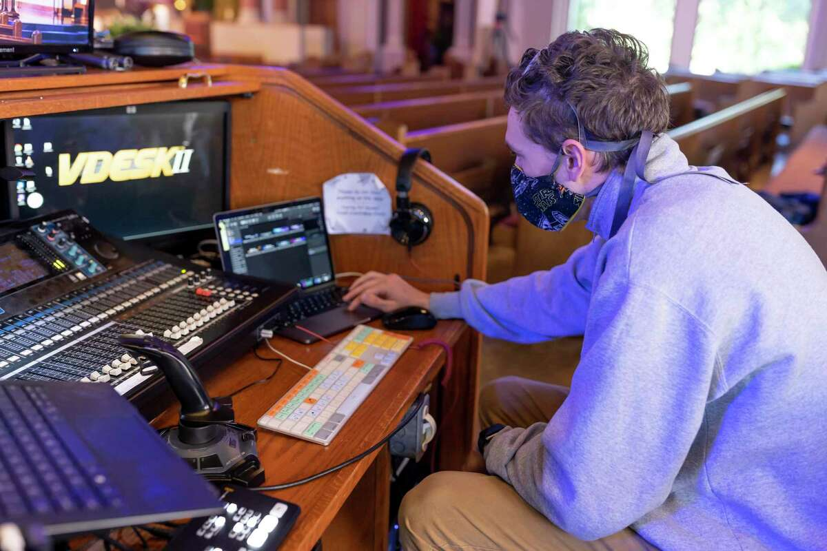 Jay Martin, creative services technician for St Anthony of Padua Catholic Church in The Woodlands, prepares his equipment before mass their regular livestream, Sunday, April 26, 2020. On average they will amass between 5,000-6,000 viewers on their livestreams for each Sunday mass.