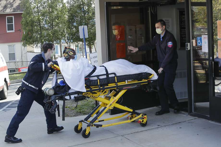 Medical workers bring a patient to the Northbridge Health Care Center in Bridgeport on Wednesday, April 22, 2020. (AP Photo/Frank Franklin II) Photo: Frank Franklin II, Associated Press