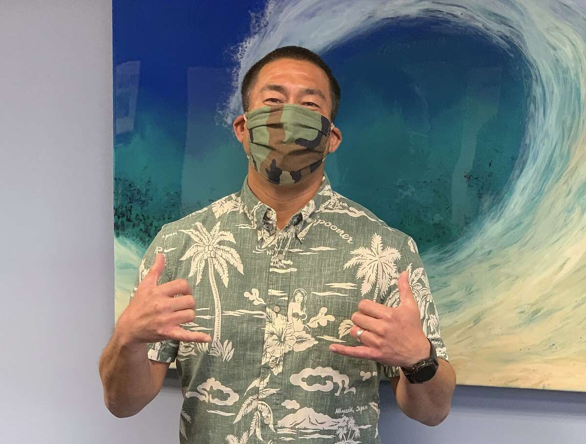 In this April 20, 2020, photo provided by the Kauai County, Hawaii, Kauai Mayor Derek Kawakami wears a mask in Lihue, Hawaii. Kawakami has imposed a curfew to curb the spread of the coronavirus and then entertains residents with nightly videos to