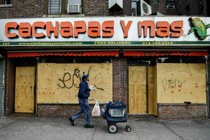 A closed business in the Washington Heights neighborhood of New York, April 23, 2020. On Sunday, Gov. Andrew M. Cuomo offered the clearest outline so far for the reopening of the business sector in the state. (Marian Carrasquero/The New York Times)