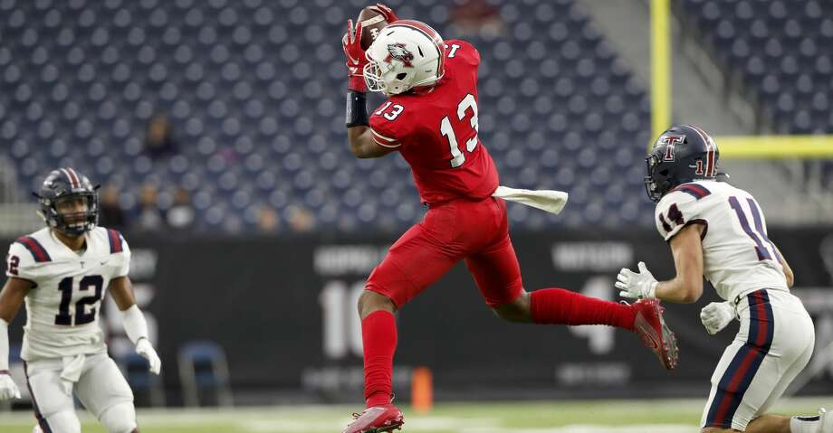 Atascocita Eagles Landen King (13) catches a pass defended by Tompkins Falcons Colby Huerter (14) during the first half of the high school football playoff game between the Tompkins Falcons and the Atascocita Eagles at NRG Stadium in Houston, TX on Saturday, November 30, 2019. The Eagles lead the Falcons 35-3 at halftime. Photo: Tim Warner/Contributor / ©Houston Chronicle