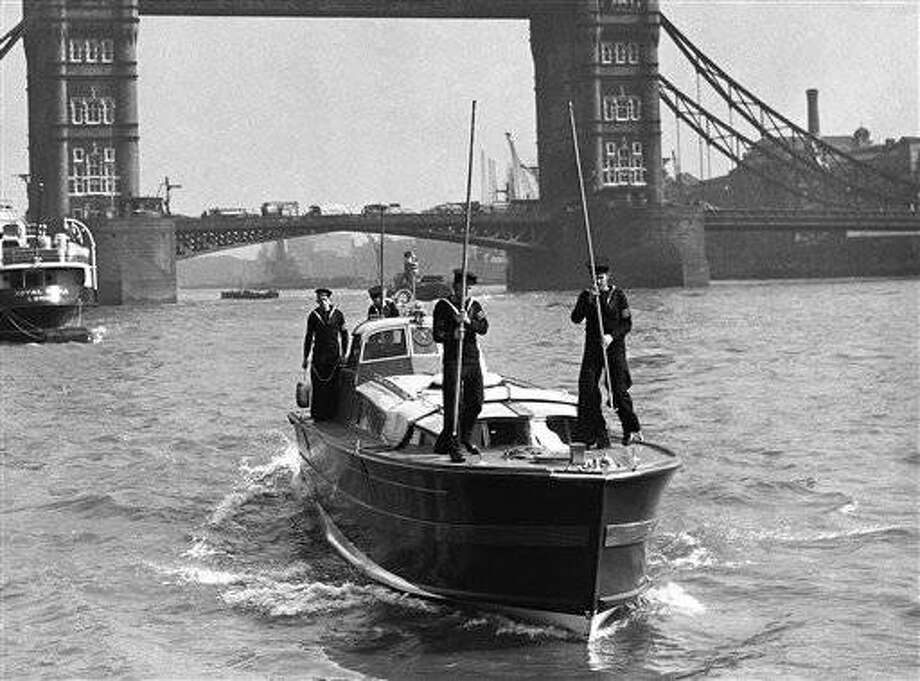 The Royal Barge in which the King is to go down the Thames to Greenwich on April 27 in order to open the new National Maritime Museum, arrived in the Pool of London on April 23, 1937. The Kings Barge arriving in the Pool of London. (AP Photo)
