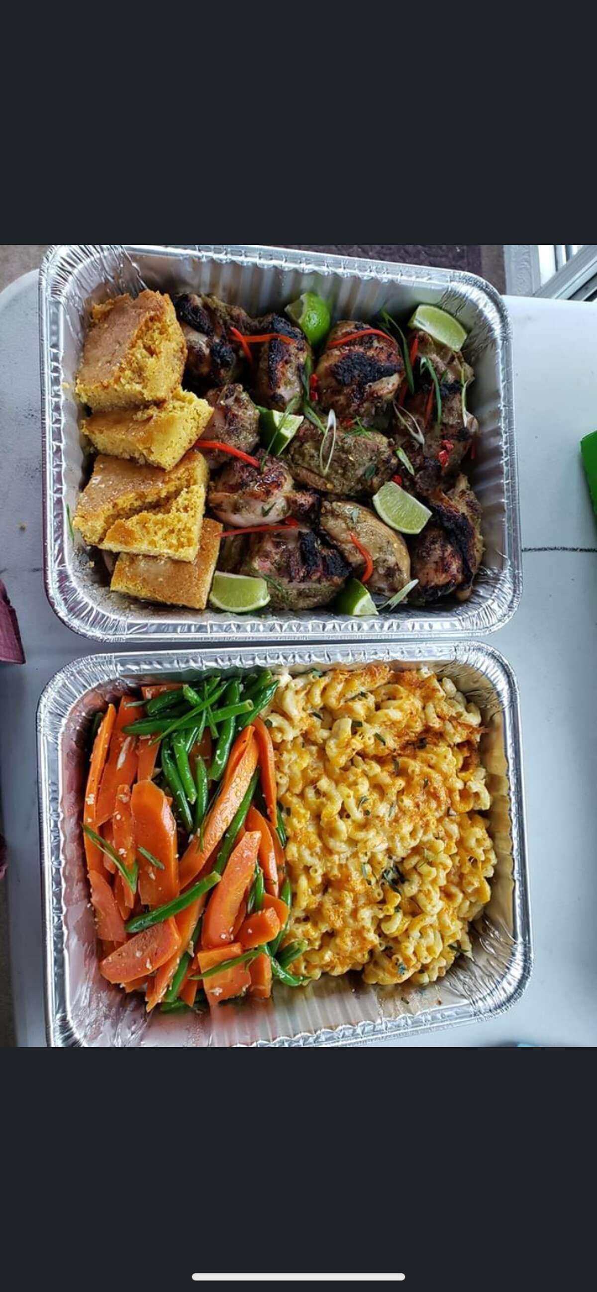 A family meal from Savoy Taproom in Albany, which includes jerk chicken and three sides.