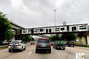 The Be Someone graffiti is seen on a railroad bridge that crosses I-45 southbound near downtown Houston on April 30, 2019.