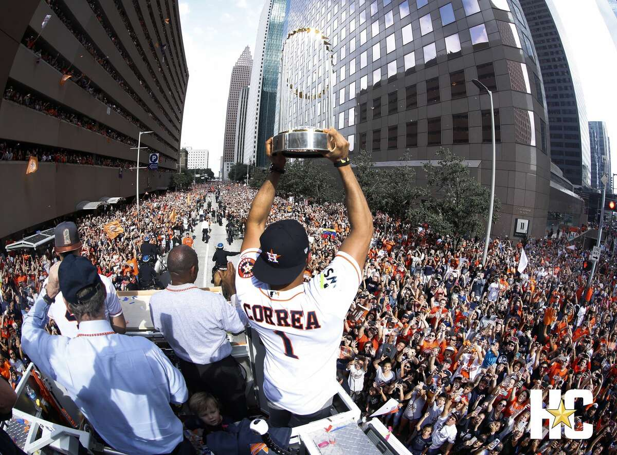Carlos Correa holds up the trophy during the Houston Astros World Series victory parade on Friday, Nov. 3, 2017.