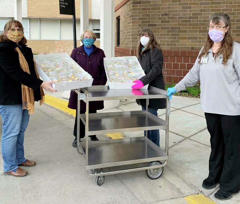 Picture delivering cookies is General Federation of Woman's Club in Big Rapids members Ann Stellard, Melanie Henry and Mary Bechaz. The group delivered cookies to all of the Big Rapids Hospital employees who work to keep the community safe and healthy. (Courtesy photo)